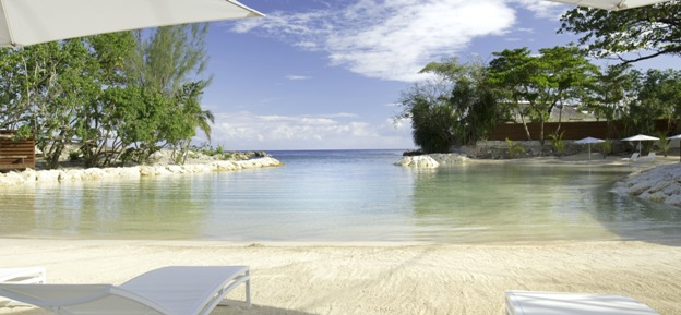 Trident Hotel private cove with sandy beach.