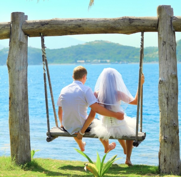bride and groom in swing by Caribbean