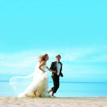 Wedding couple on the beach at Sandals Resort