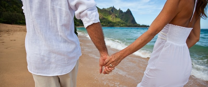 Couple holding hands on Hawaii beach