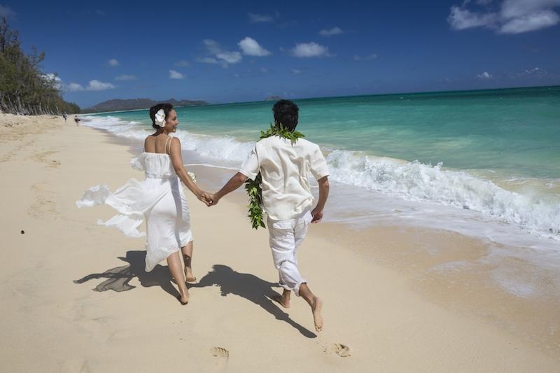 Couple running on sandy beach