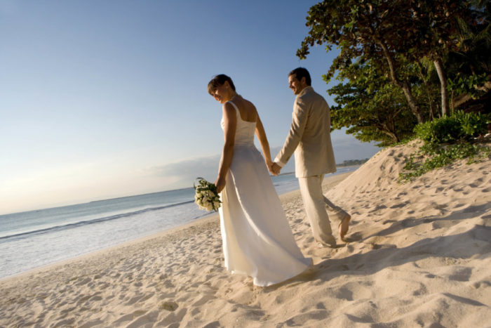 A post-wedding stroll on the beach at the InterContinental Bali