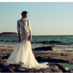 Modern poet sleeves are just the ticket for a bride who want a bit of romantic flair. Dress by Christos Costarellos.
