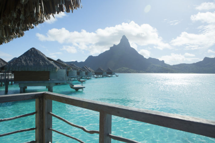 If the frigid winter has you dreaming of a tropical wedding, Bora Bora is one of 5 top spots I listed for Observer—and paired with fantastic bridal gowns.